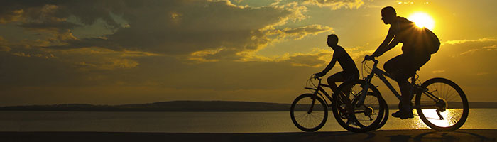 Two bicyclers in the sunset